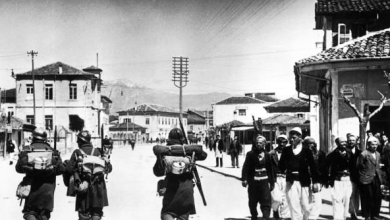 Italian_soldiers_passing_Albanians,_7_April_1939