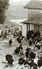 """Jäckh153: """"Albanian Catholics attending mass with their rifles at hand"""" (Photo: Ernst Jäckh, ca. 1910. Courtesy of Rare Books and Manuscript Library, Columbia University, New York, 130114-0004)."""