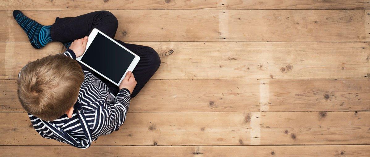 boy-tablet-wood-flooring-healthy