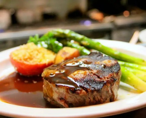 Steak with gravy and vegetables