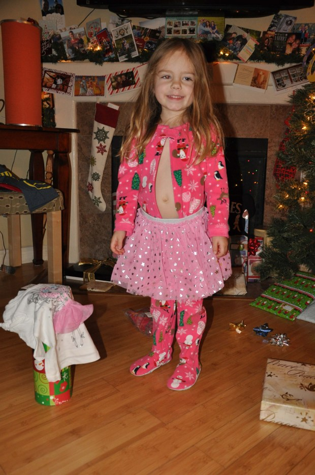 """We had to put on the fairy princess skirt - right away! Notice the belly button? We have to unzip the """"jammas"""" so she can get to her belly button, or else it's ALL OVER folks!"""