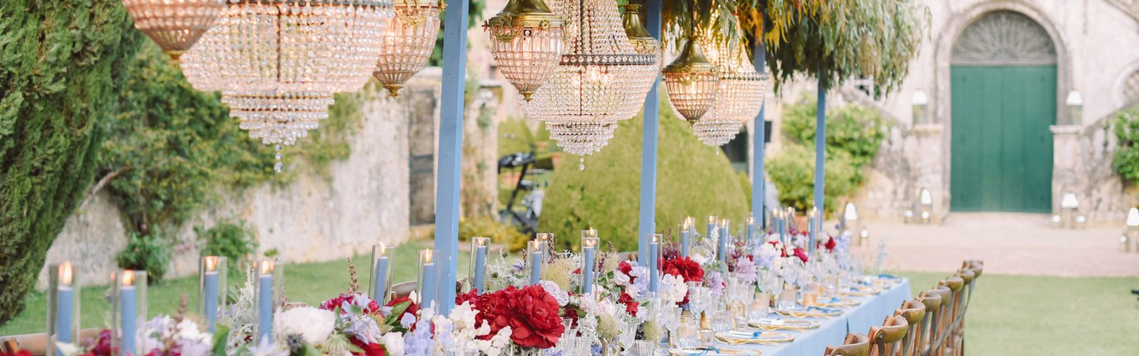 Wedding Reception Table Red Flowers and Green hanging Plants