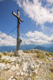 Summit cross of Gamsknogel, above Jochberg and Inzell, Bavaria, Germany. August 2008.