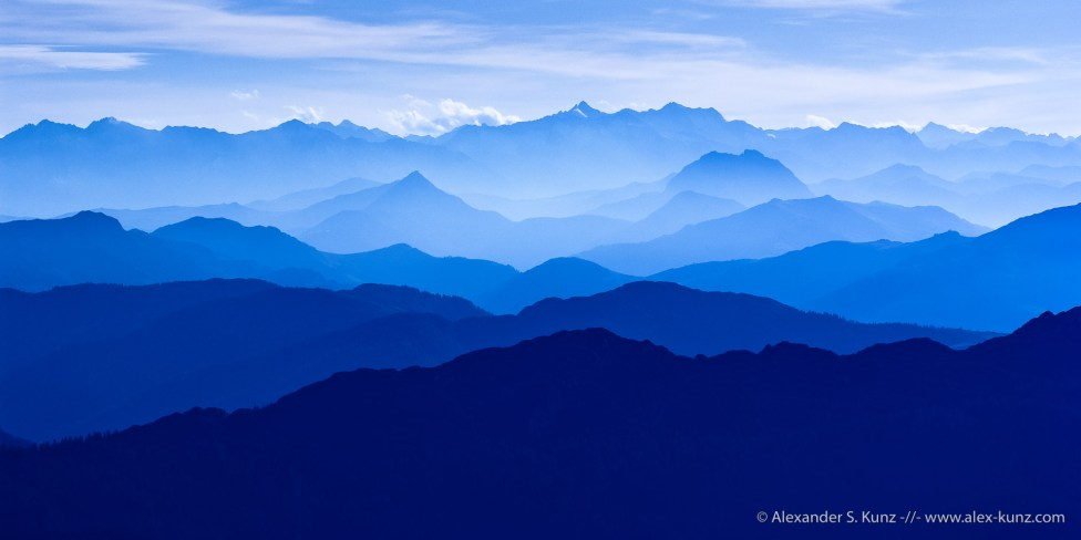 Mountain silhouettes in blue