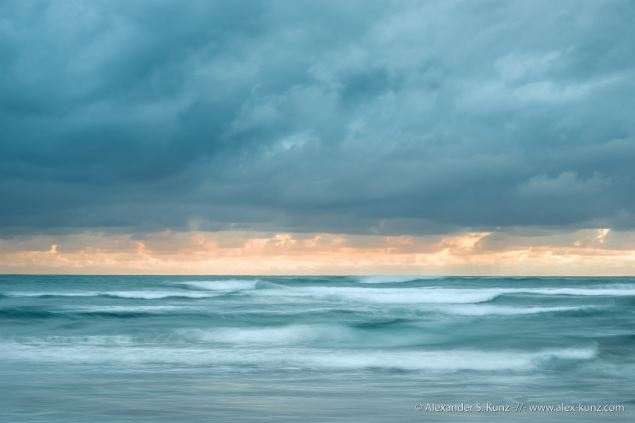 Surf and clouds on a stormy February evening at Cardiff State Beach, Encinitas, CA.