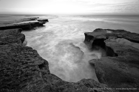 Black & white long exposure of tidepools at Tabletop Reef, Seaside State Beach, Cardiff By The Sea, California. March 2011.