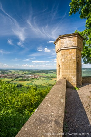 View into the land and towards villages below Hohenzollern Castle, Bisingen, Baden-Württemberg, Germany. June 2014.