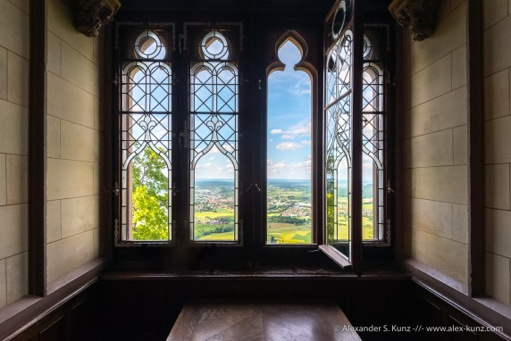 Looking onto the land through a window at Hohenzollern Castle, Bisingen, Baden-Württemberg, Germany. June 2014.