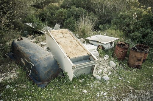 Bath tubs, barrels and a fridge illegaly disposed at a side road near Muro, Mallorca, March 2008.