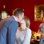 Bride and groom first kiss as a married couple