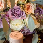 Wedding ring box and bouquet detail photo