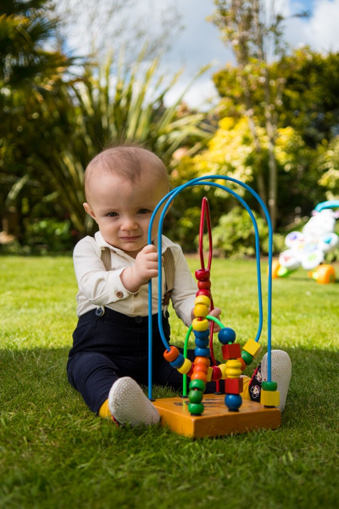 Young boy playing with a toy