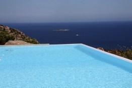 Overflow heated swimming pool