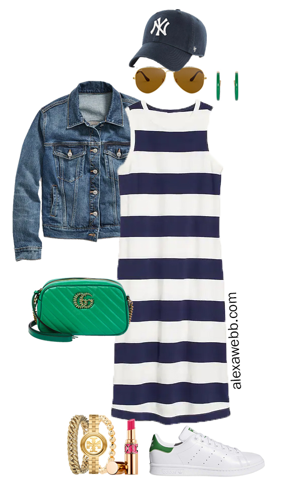 A plus size rugby stripe dress outfit with sneakers, denim jacket, and green crossbody bag. Perfect for a fall casual outfit. Alexa Webb