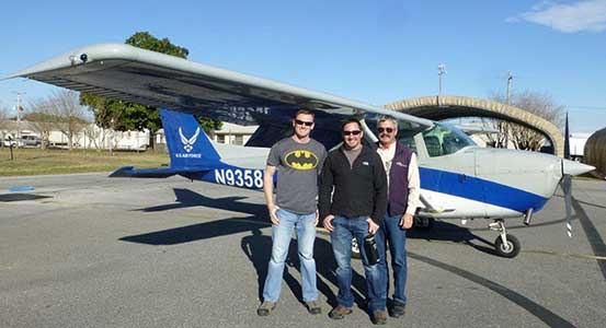 Pilot Cole Pasley with Geoff and Todd Gilmer.