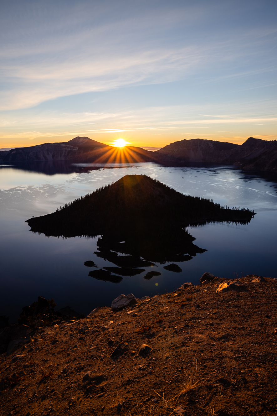 Sun peaking over ridge at Crater Lake National Park.