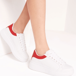 Misguided white lace up trainers with red tab