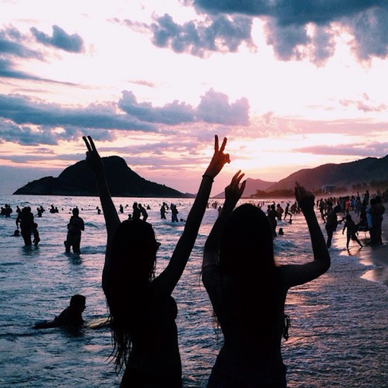 Girls at a sunset beach party