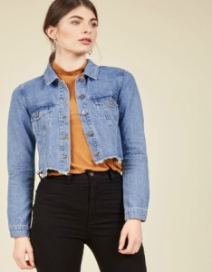Cropped denim jacket with jagged edge detail in blue