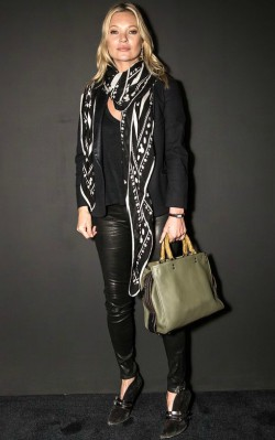 Kate Moss black and white oversized scarf with leather jacket backstage