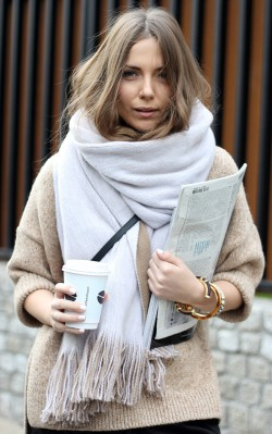 Elizabeth Olsen - wearing neutral oversized scarf holding coffee