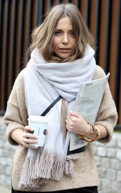 Elizabeth Olsen - wearing neutral oversized scarf holding coffee