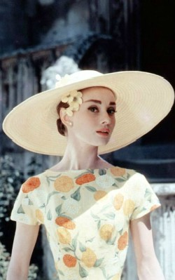 Audrey Hepburn semi formal style yellow sundress with flowers and wide rimmed hat - shop the look