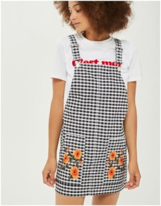 Black and white gingham pinafore with embroidered flowers and white slogan tee