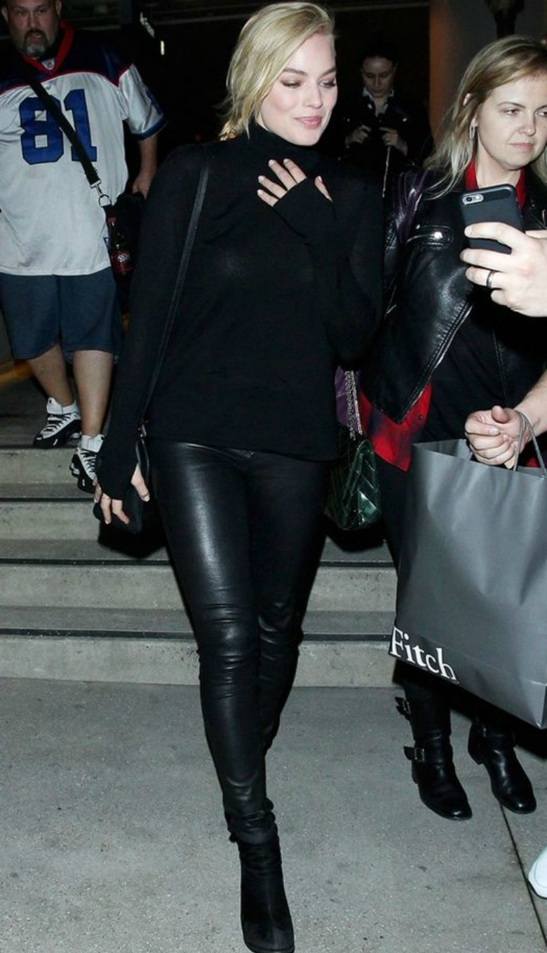 Margot Robbie street style black cashmere jumper, with black leather pants and boots - shop the look