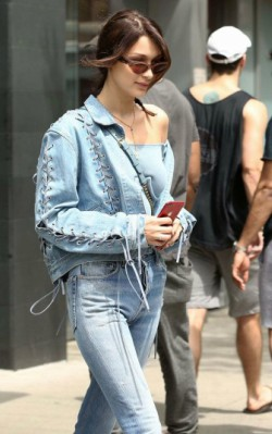 Bella Hadid street style blue jeans, blue denim jacket and blue crop top with trainers - shop the look