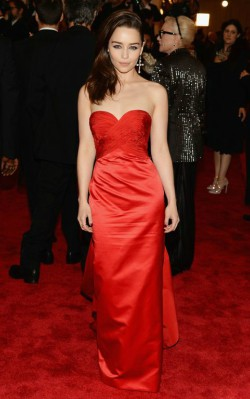 Emilia Clarke in red strapless ball gown at award show