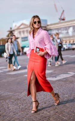Woman in red pencil skirt with front slit and a pink shirt - 50 best pencil skirts