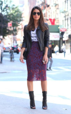 Woman in purple lace overlay, leather jacket and slogan t-shirt - 50 best pencil skirts