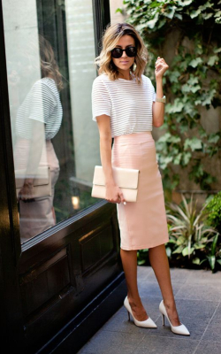 Woman in pink pencil skirt and white top - 50 best pencil skirts