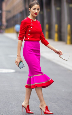 Olivia Culpo in red and pink pencil skirt and a red sweater