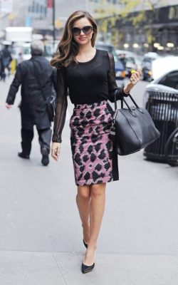 Miranda Kerr in pink and black pencil skirt and black shirt