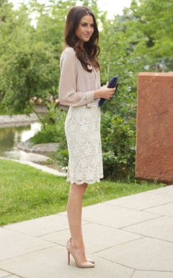 Model wearing white lace pencil skirt and pink blouse