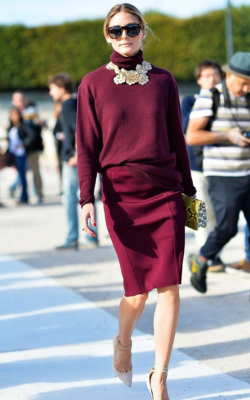 Olivia Palemero in burgundy pencil skirt and jumper