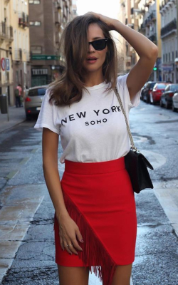 Woman in red pencil skirt with fringe detail and slogan t-shirt - 50 best pencil skirts