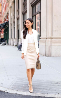 Woman in cream pencil skirt and white blazer