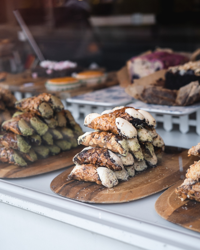 cannoli stacked in cafe window