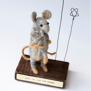 needle felt art mummy mouse holding baby with wire stars standing on a wooden plinth