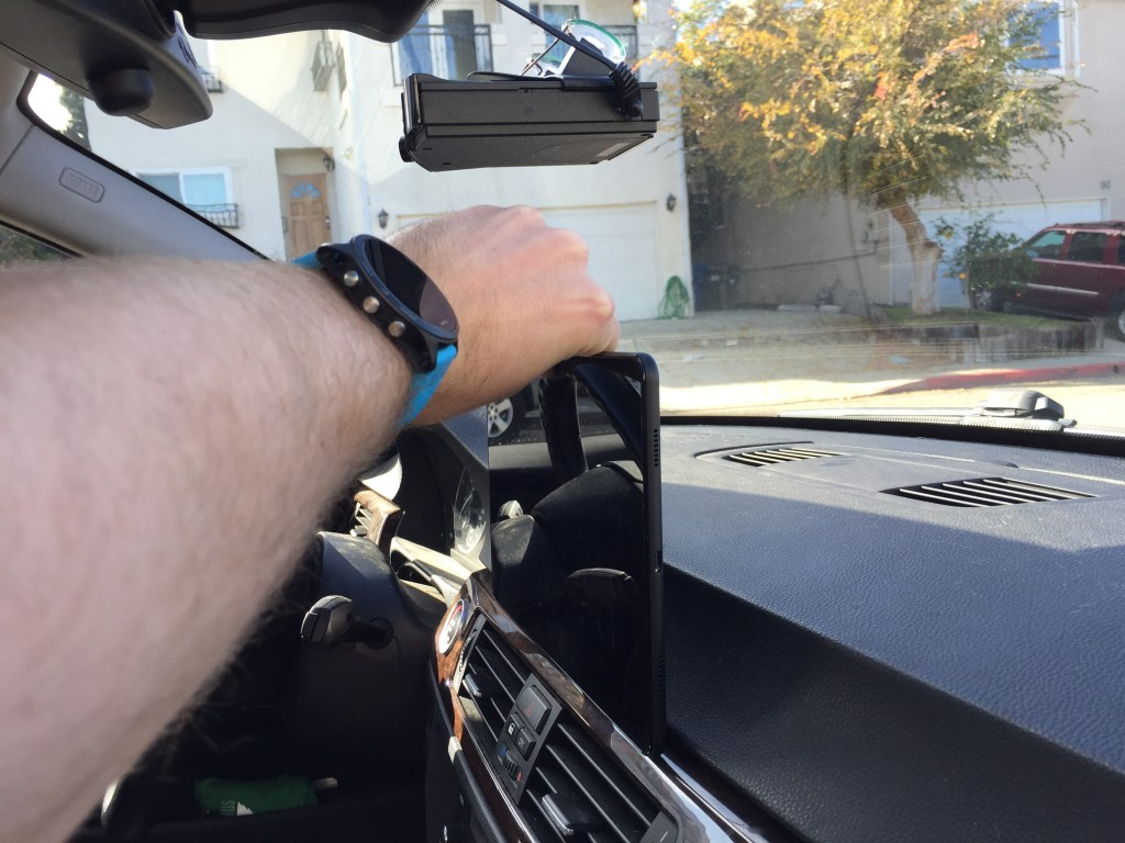 Dashboard with tablet held in place by hand