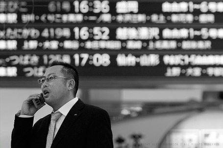 Salary man makes a last call before boarding the bullet-train: Tokyo