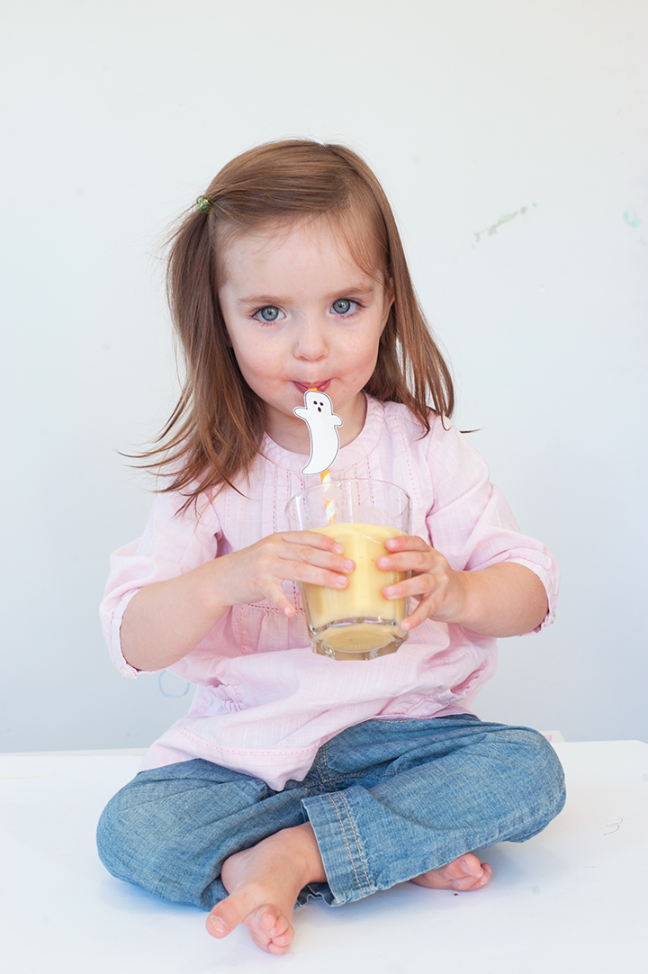 Perfect Halloween treat that's good for you! A mango smoothie topped with a ghost straw.