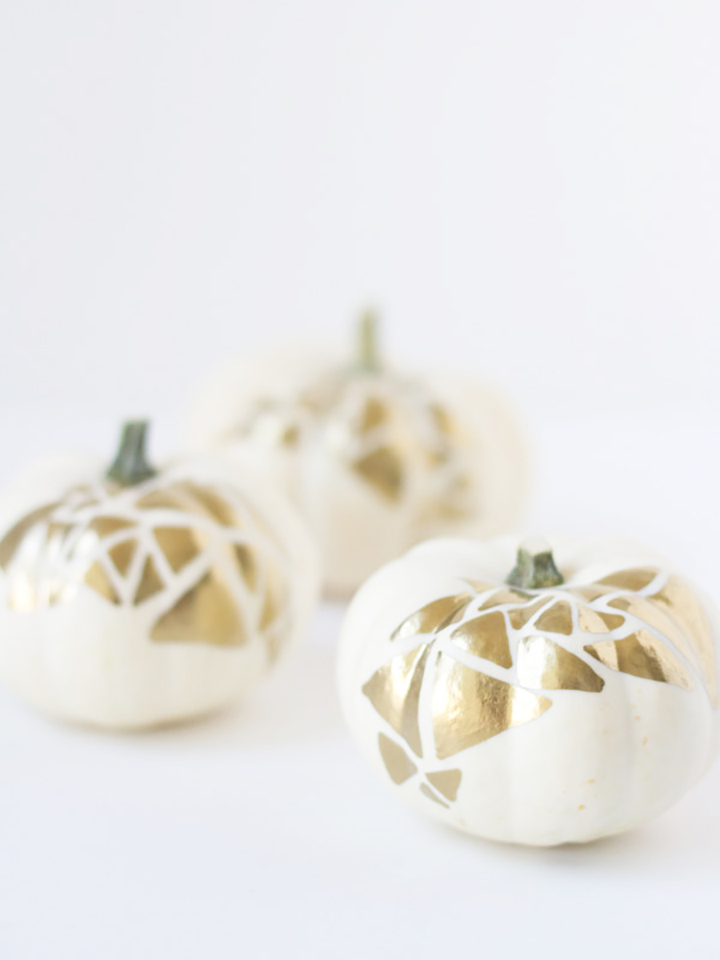 DIY tutorial for these gorgeous gold painted pumpkins from Lovely Indeed