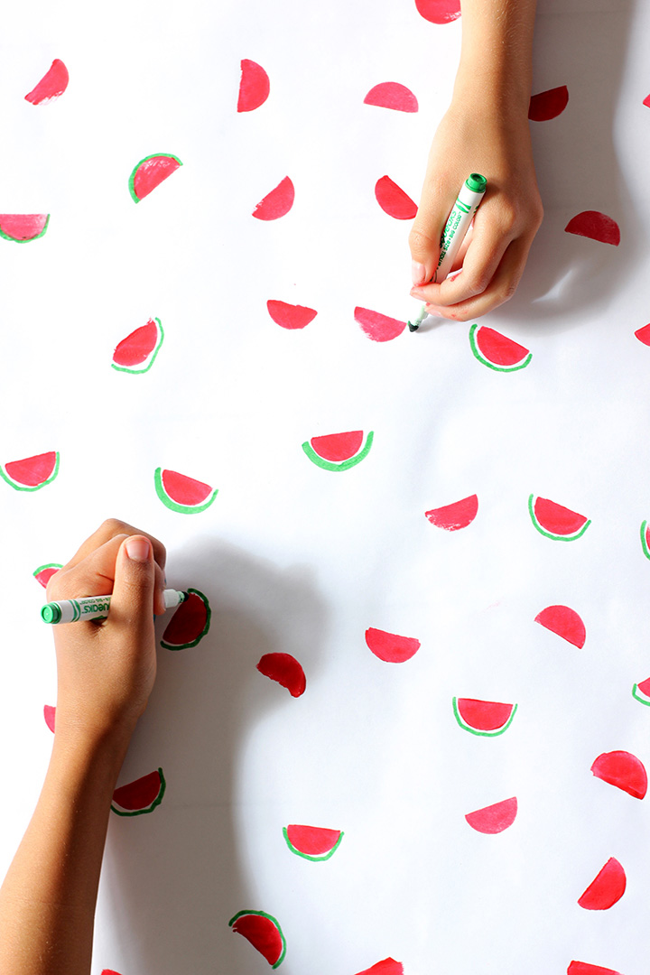 The kids will love making this DIY Stamped Watermelon Wrapping Paper