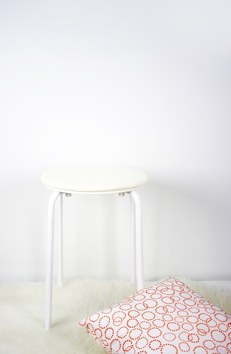 Materials for DIY fuzzy stool: IKEA stool with pillow and fuzzy faux sheepskin rug