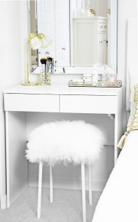 DIY fuzzy stool pictured underneath a white dressing table in girl's bedroom