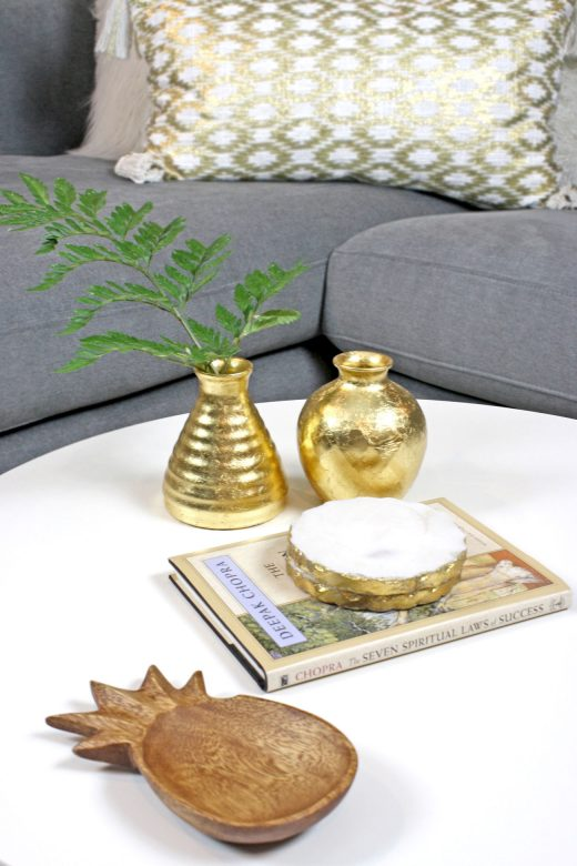 DIY IKEA gold leaf vases styled on coffee table with marble coasters and wooden pineapple